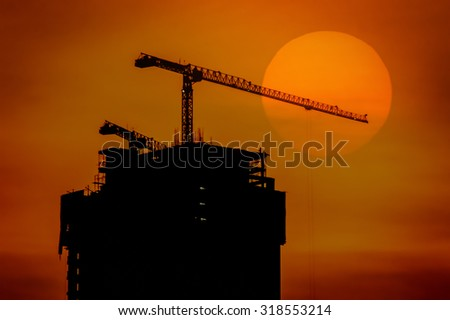 The industrial construction cranes and building silhouettes - stock photo