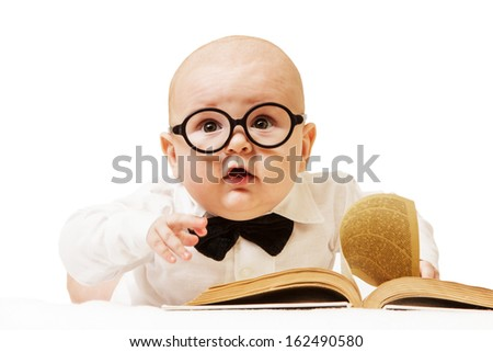 The ingenious child wearing spectacles and with the book