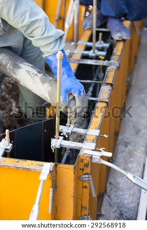 The injection work the concrete to make the foundation of the construction work residential housing