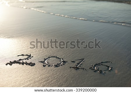 the inscription on the sand coming year - stock photo