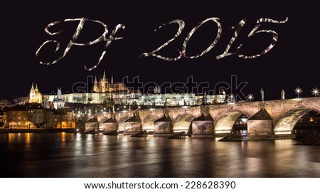 """The inscription """"PF 2015"""" above the panorama of Prague Castle with Charles bridge - stock photo"""