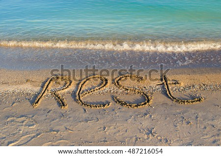 The inscription rest on sand. Shooting on the beach.
