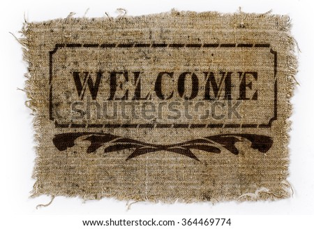 "The inscription ""Welcome"" in a frame, drawn on a piece of old canvas"