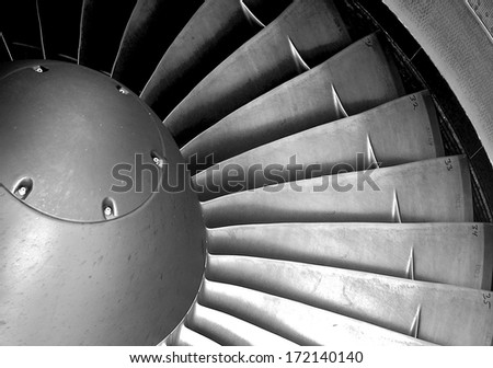 The intake vanes in a jet engine form a striking geometric,making a technical subject into an intriguing pattern. - stock photo