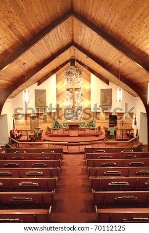 The interior of a beautiful church bathed in warm glowing light. - stock photo