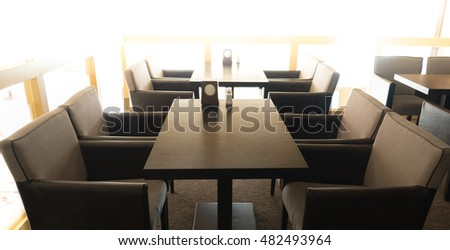 The interior of a cafe or restaurant, lounge. Table and chairs, picture window.
