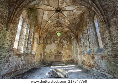 The interior of a forgotten church - stock photo