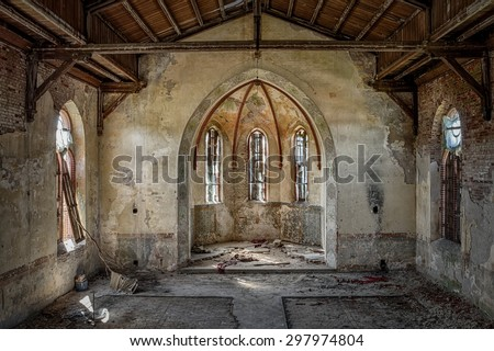 The interior of an abandoned church - stock photo