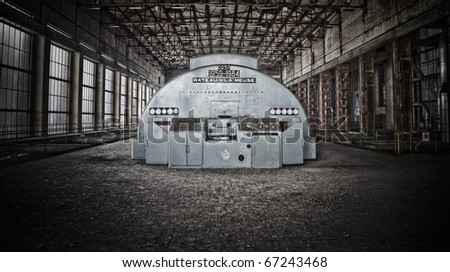 The interior of an old industrial area, tha main hall where the big generator used to do his job - stock photo
