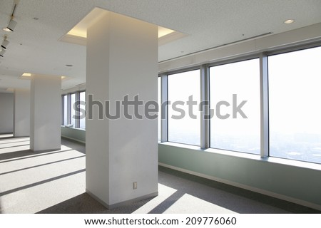 The Interior Of High-Rise Building Receiving Sunlight - stock photo
