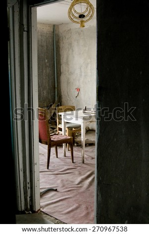 The interior of one of the apartments in multistory abandoned in Pripyat ghost town, Chernobyl Nuclear Power Plant Zone of Alienation, Ukraine - stock photo