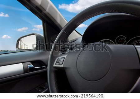 The interior of the car with the approximation of the steering wheel - stock photo