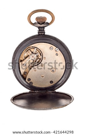 The interior of the clock mechanism on a white background. - stock photo