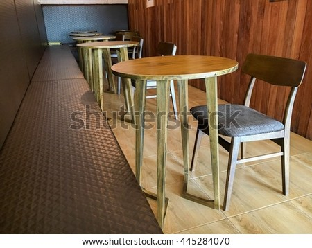 The interior wooden table and chair in vintage corner of the coffee shop.