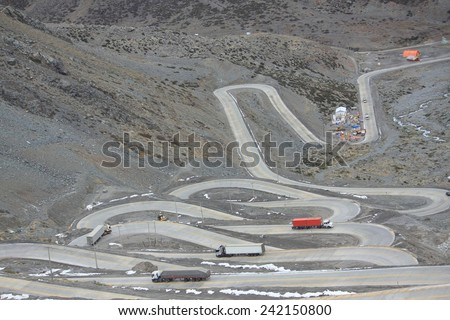 the international road with many switchbacks between Santiago and Mendoza - stock photo