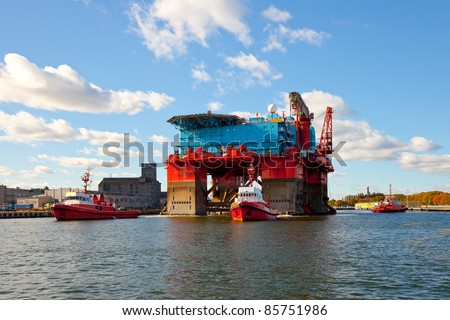 The introduction of a drilling rig to a shipyard for repairs - stock photo