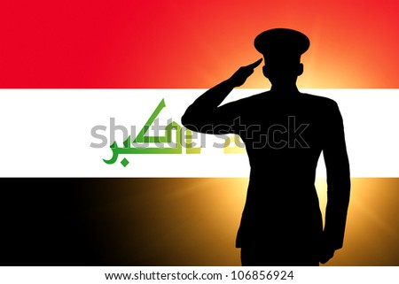 The Iraqi flag and the silhouette of a soldier's military salute - stock photo