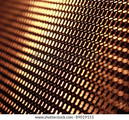 The iron cast of a metal frame grid (or sieve) as seen against a black background - stock photo