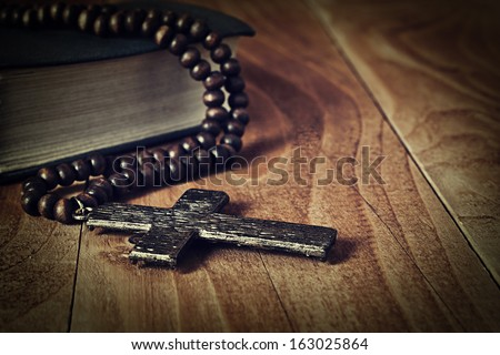 The iron cross on a wooden surface closeup - stock photo