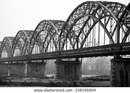 "The iron ""Gerola Bridge"" on the Po river, Lombardy (Northern Italy, in the Province of Pavia). Black and white photo - stock photo"