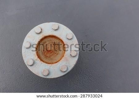 The iron valve on deck floor of navy ship - stock photo