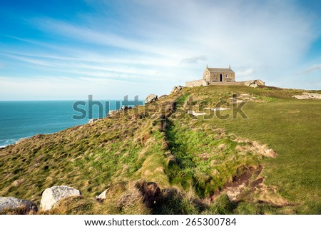 The Island at St Ives in Cornwall, a grassy knoll that rises above the town and is a small peninsula, the chapel at the top is St Nicholas' Chapel - stock photo