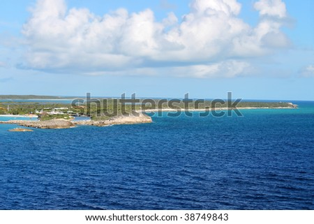 The island of Half Moon Cay in the Bahamas with beautiful turquoise blue waters - stock photo