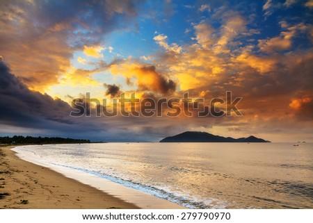 The island of Nosy Mangabe at sunrise, seen from the beach of Maroantsetra, Madagascar - stock photo