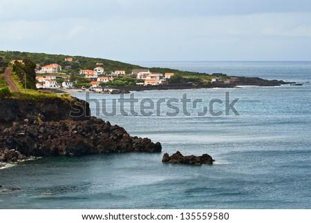 The island Pico, a village on the shores of the Atlantic ocean - stock photo