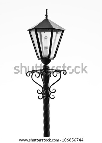 The isolated black metal streetlight with a bulb - stock photo