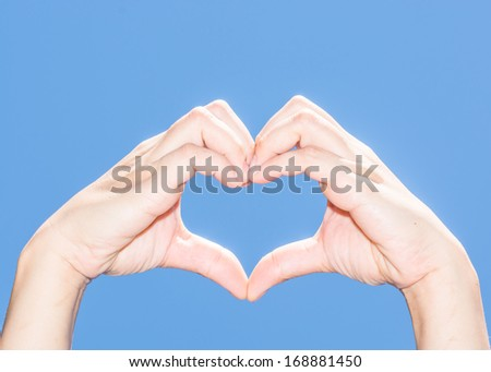 The isolated female hand showing her heart indicates her love to everyone