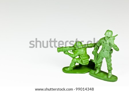The isolated image of two plastic toy soldiers