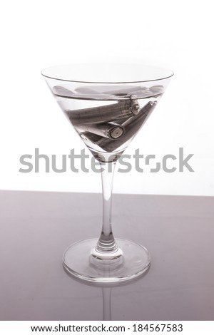 the isolated of old AA battery in wine glass is energy consumption concept on white background