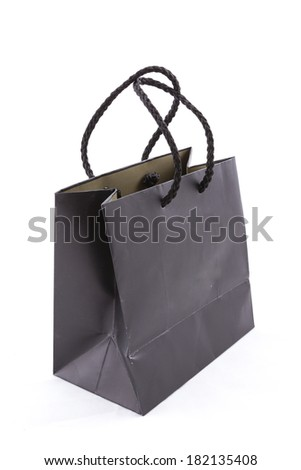 the isolated of the black paper bag for shopping on a white background