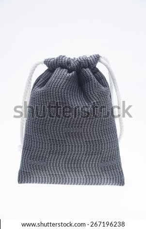 the isolated of the woven bag is rope pattern for money pouch on a white background - stock photo