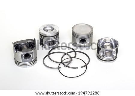 The isolated white automobile piston parts - stock photo