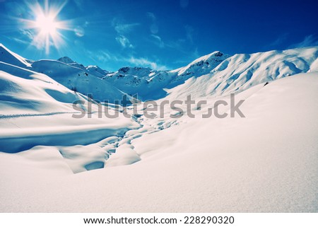 The italian alps in winter - stock photo