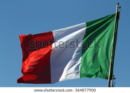 the Italian flag waving in the sky