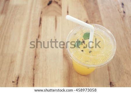 The Italian Soda with passion fruit favor with selective focus on the lid from the top view shot concept of summer drink - stock photo