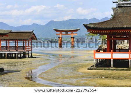 "The Itsukushima Shrine in Miyajima island. Itsukushima is a shrine on the island of Itsukushima (popularly known as Miyajima) near Hiroshima, best known for its ""floating"" torii gate.  - stock photo"