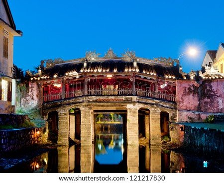 The japanese bridge, in the old quarter of Hoi An, Vietnam. UNESCO world heritage site and famous touristic destination. - stock photo