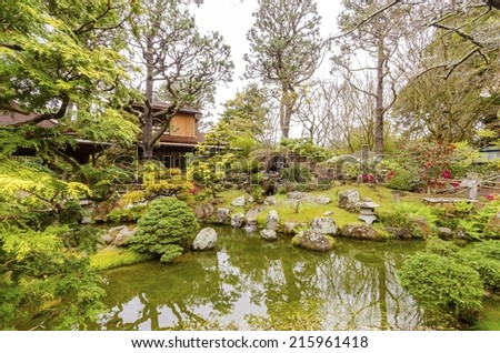 The Japanese Tea Garden in Golden Gate Park in San Francisco, California, United States of America. A view of the native Japanese and Chinese plants,red pagodas and pond that create a relaxing scenery - stock photo