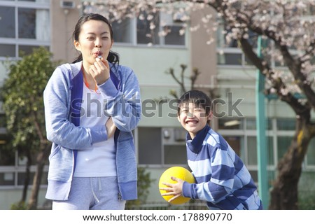 The Japanese woman teacher who plays a flute - stock photo