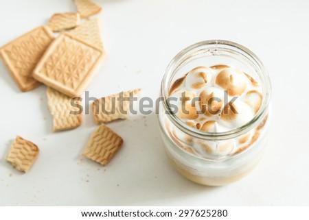 The jar cake with lemon curd and meringue - trendy American dessert - stock photo