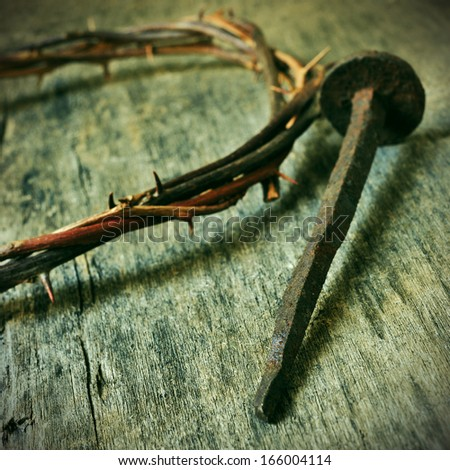 the Jesus Christ crown of thorns and a nail on the Holy Cross - stock photo