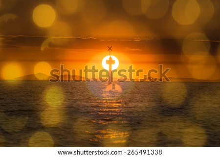 The Jesus cross in the sea with the sun and yellow bokeh background. - stock photo