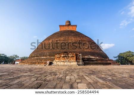 The Jetavanaramaya is a stupa, located in the ruins of Jetavana Monastery in the sacred world heritage city of Anuradhapura, Sri Lanka. - stock photo