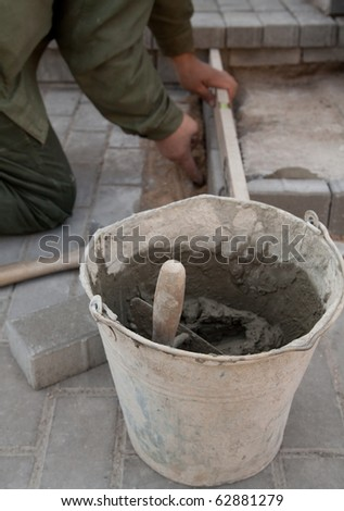 The job of a bricklayer requires skill and experience - stock photo