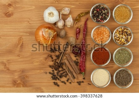 The joy of cooking, preparation of spices. Various kinds of spices on a wooden board. Food preparation. Spices on the kitchen table.