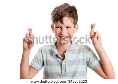 the joyful boy crossed fingers for good luck
